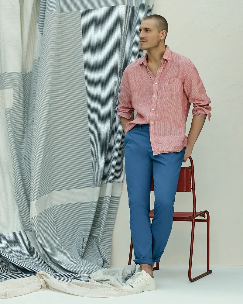 Going casual, Mike Guenther dons a red Baird McNutt Irish linen shirt, J.Crew 770 straight-fit garment-dyed chinos, and Pro-Keds Royal Lo sneakers.
