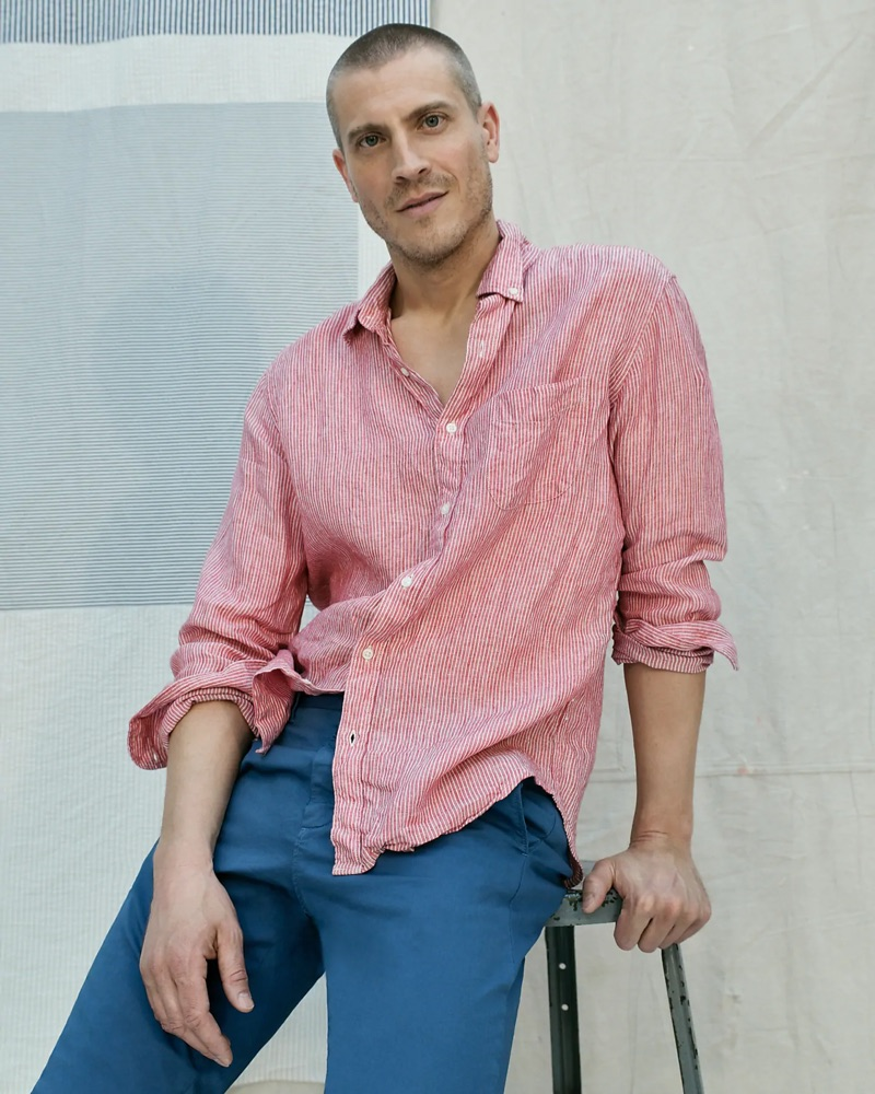 A relaxed vision, Mike Guenther dons a red Baird McNutt Irish linen shirt, J.Crew 770 straight-fit garment-dyed chinos, and Pro-Keds Royal Lo sneakers.
