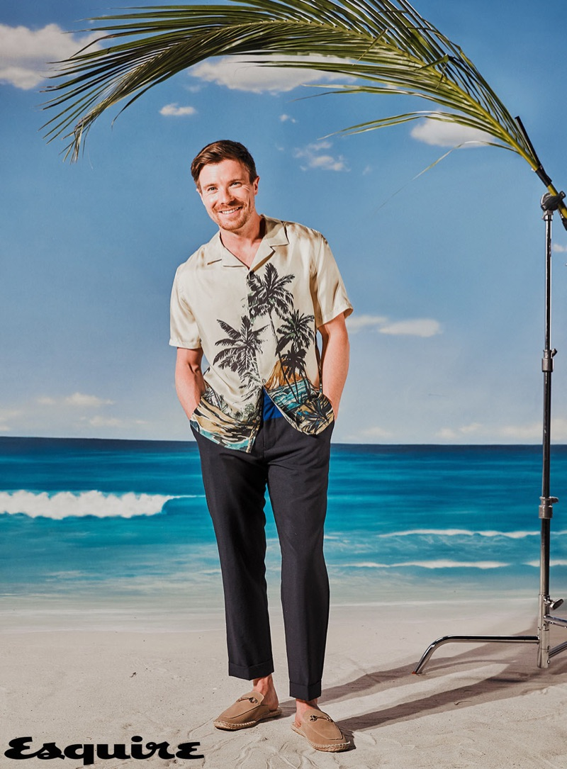 Embracing summer style, Joe Dempsie sports a shirt by The Kooples with Tommy Hilfiger trousers, and ASOS loafers.