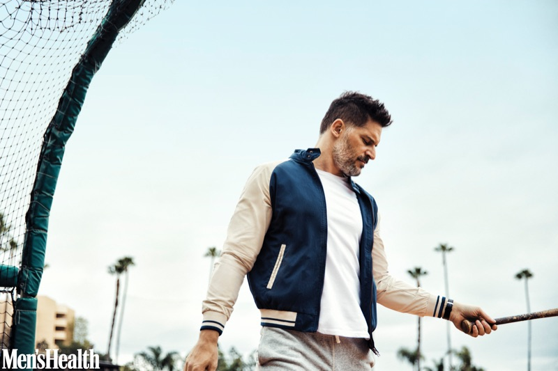 Connecting with Men's Health, Joe Manganiello sports a Ben Sherman jacket, Calvin Klein t-shirt, Todd Snyder + Champion sweatpants, and a Movado watch.