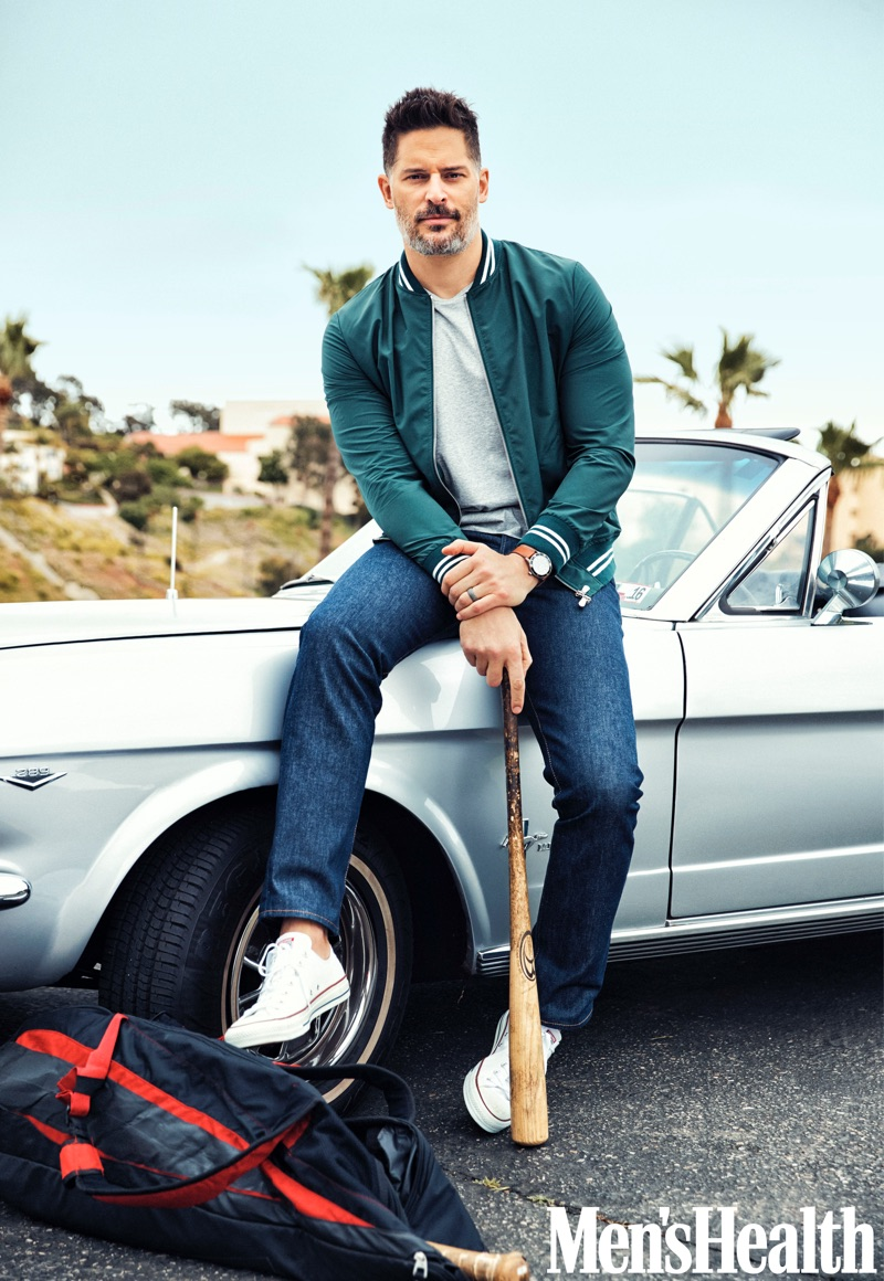 Actor Joe Manganiello wears an Eleventy jacket, Calvin Klein t-shirt, Levi's jeans, and Converse sneakers with a Movado watch.