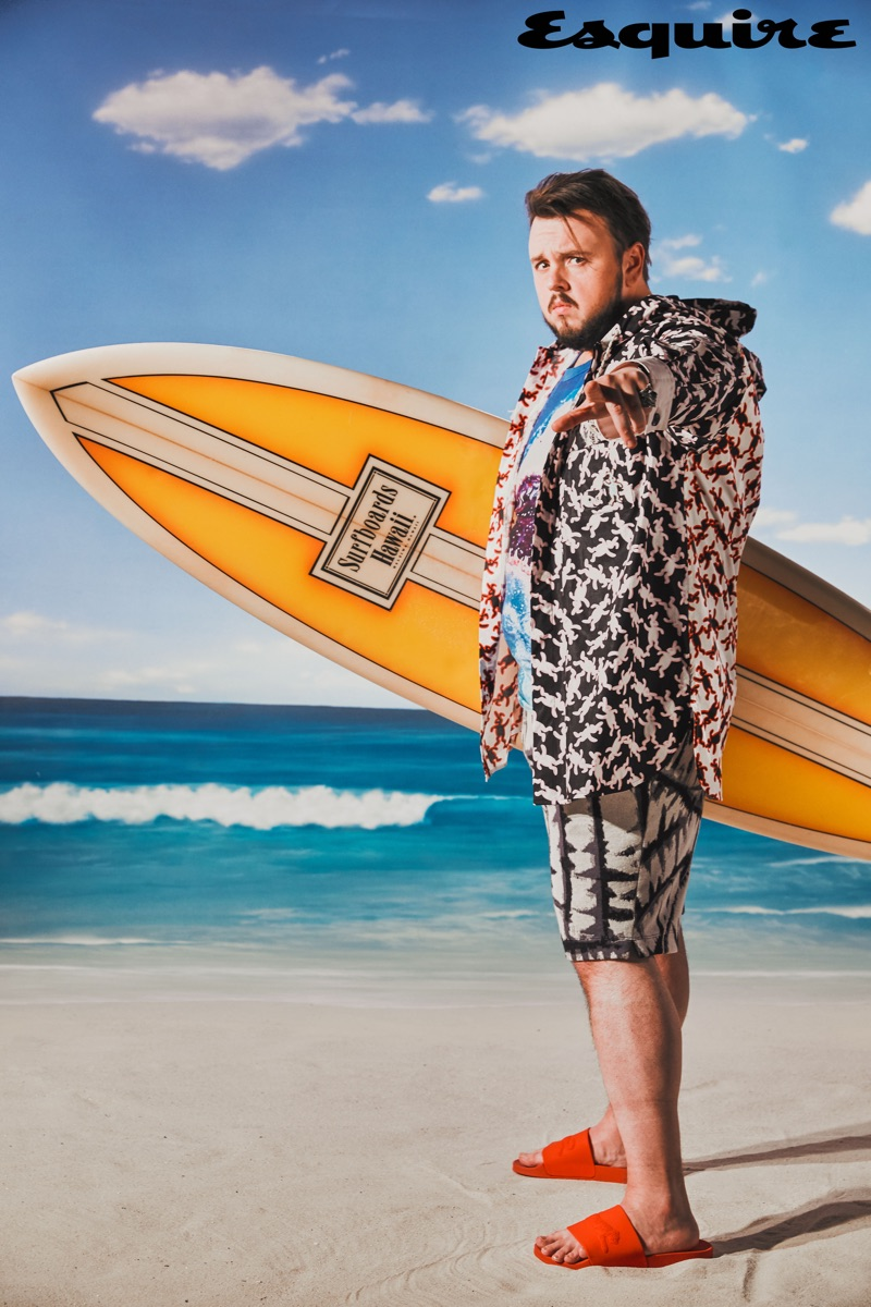 John Bradley wears a Marni jacket, MSGM shirt, Twenty Montreal shorts, Gucci ring, and Le Tigre sandals.