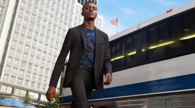 Donning a suit, Jubril Oyedeji appears in Kenneth Cole's spring-summer 2019 campaign.