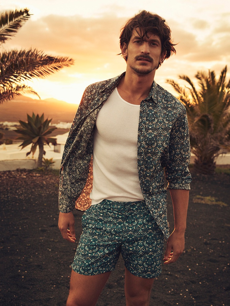 Jarrod Scott models a shirt and shorts from Liberty London's travel and swim collection.