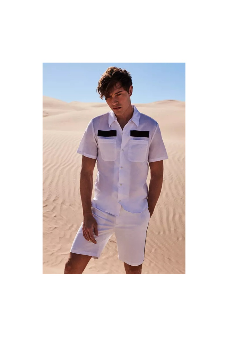 Front and center, Francisco Lachowski sports a Calvin Klein scout shirt $79.50 and flat-front shorts $79.50.