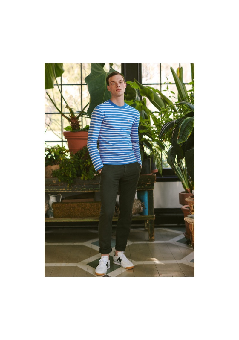 Rocky Harwood dons a striped Maison Kitsuné tee with Theory pants and Karhu ChampionAir sneakers. He also sports Miansai's bracelets.