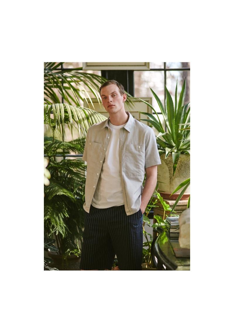 Model Rocky Harwood wears a Maison Kitsuné shirt, t-shirt, and seersucker shorts.