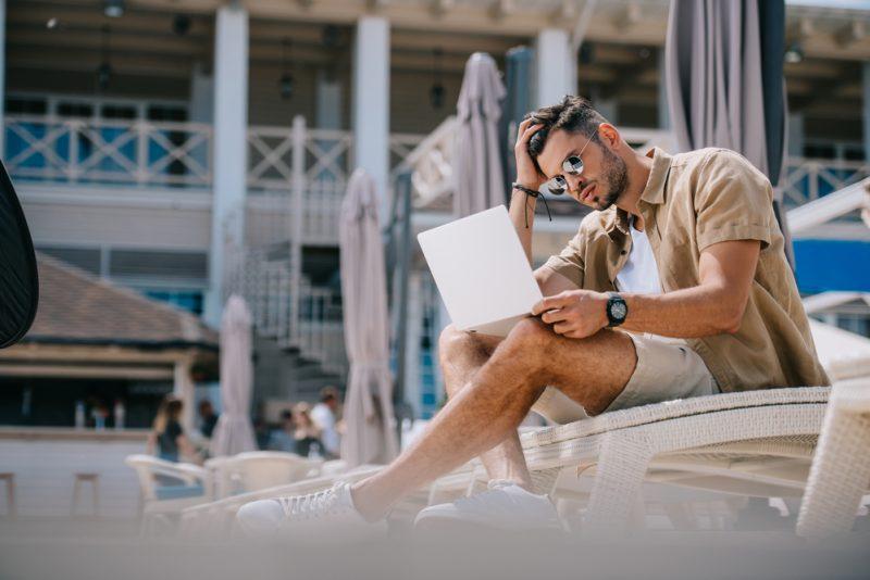 Man on Laptop Working Luxury Resort