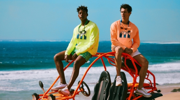 Taking to the beach, Ty Ogunkoya and Vincent LaCrocq sport highlighter-colored tees and swim shorts from Mango's Mistral collaboration.