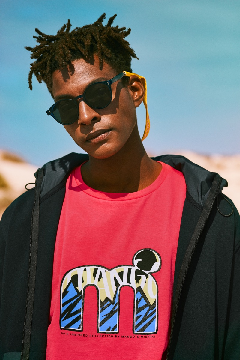 Channeling 90s style, Ty Ogunkoya sports a graphic t-shirt from Mango's Mistral collaboration.