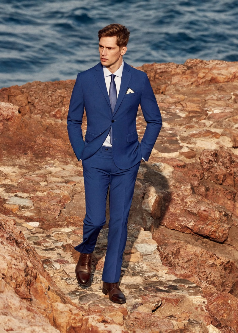 Donning a blue suit, Mathias Lauridsen connects with Mango.