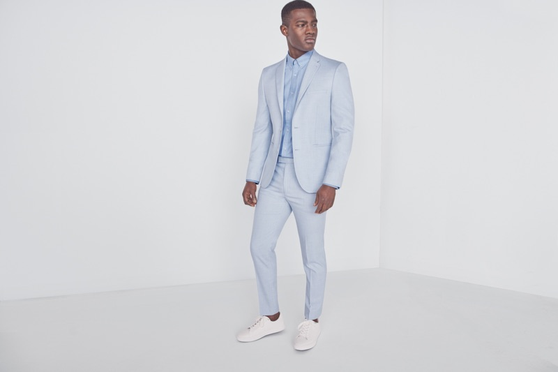 Kesse Donkor wears summer suiting from Marks & Spencer.