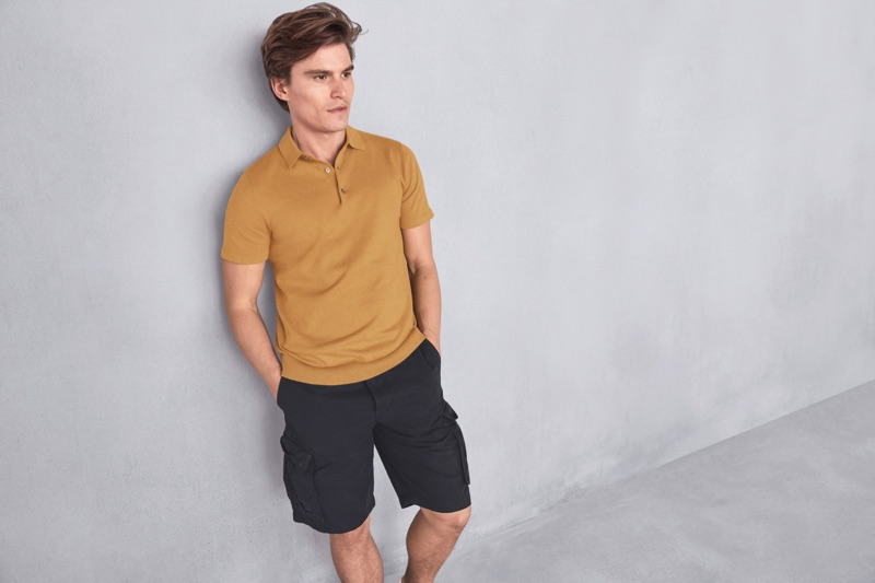 A smart vision, Oliver Cheshire wears a polo shirt and cargo shorts from Marks & Spencer.