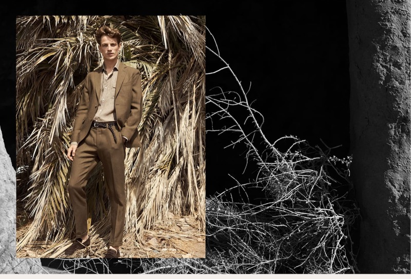 Donning a brown suit, Hugo Sauzay wears Massimo Dutti.