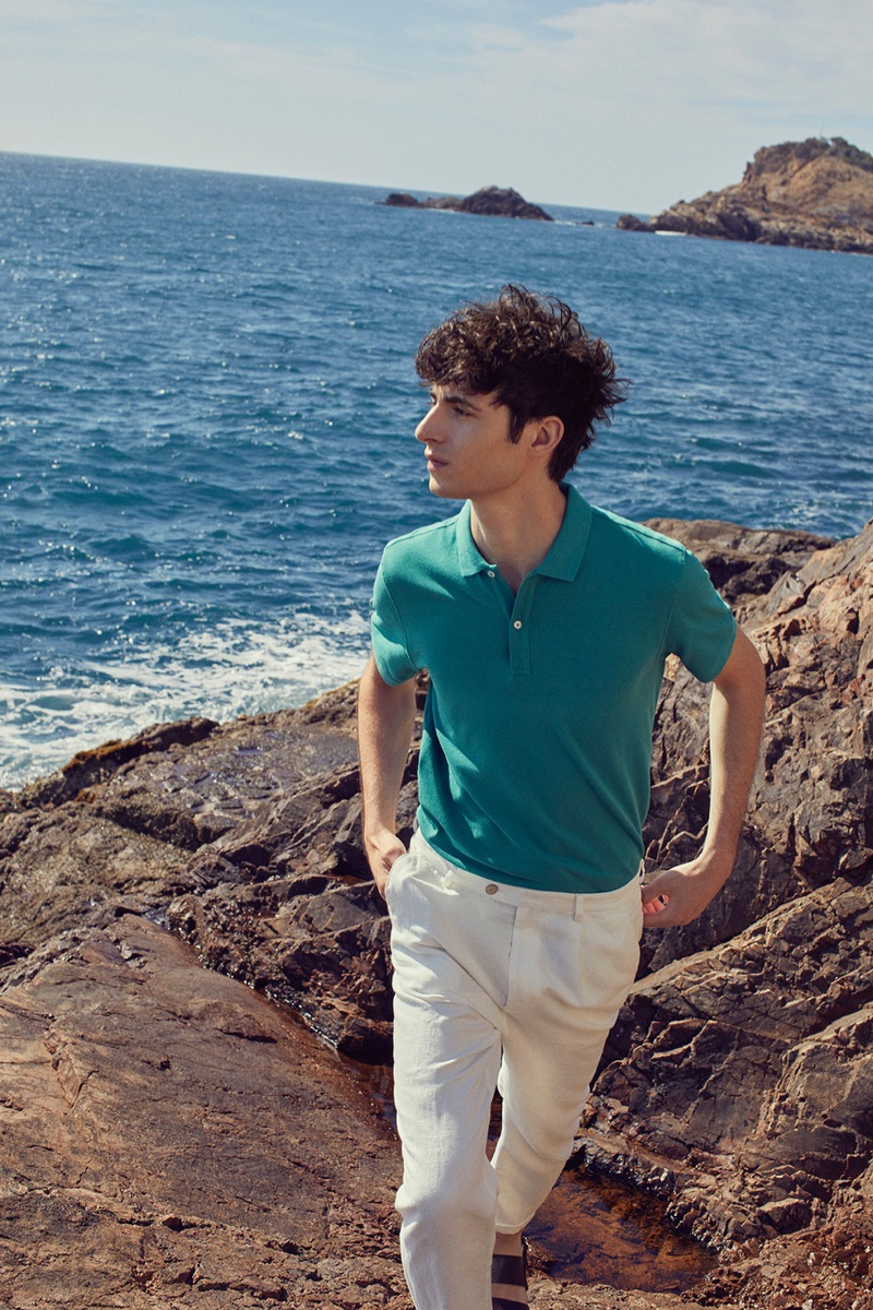 Embracing smart style, Oscar Kindelan dons a polo for Massimo Dutti's summer 2019 campaign.