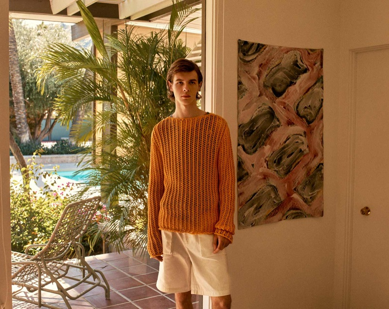 Efraim Schröder dons a Jacquemus sweater with a Marrakshi tank and P. Johnson shorts.