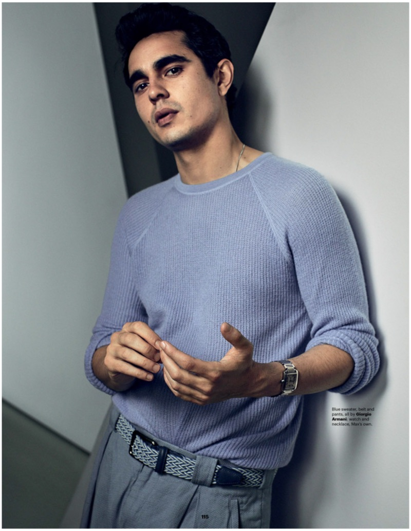 A chic vision, Max Minghella dons a sweater, belt, and pants by Giorgio Armani.
