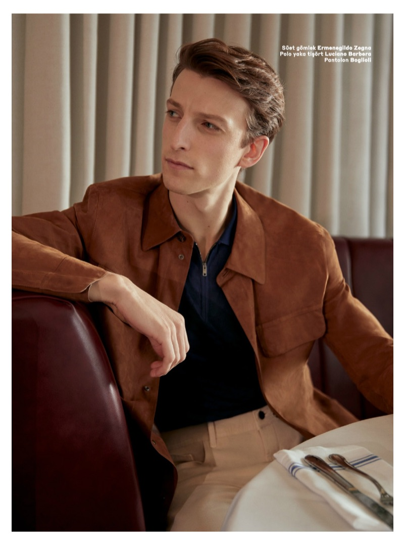Max Townsend dons an Ermenegildo Zegna suede jacket with a Luciano Barbera half-zip polo and Boglioli pants.