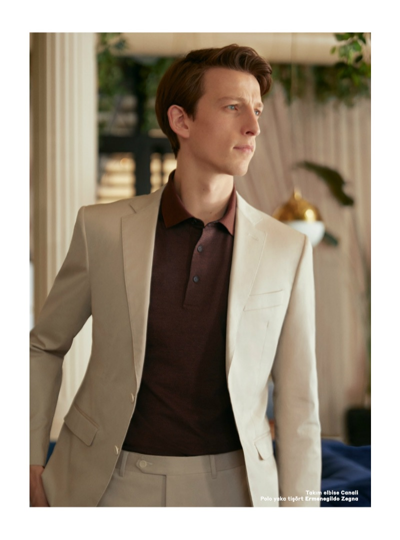 Embracing neutrals, Max Townsend models a Canali suit with an Ermenegildo Zegna polo.