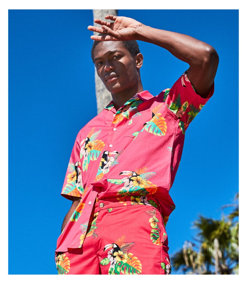 Hamid Onifade wears a red Club Room camp collar graphic shirt $49.50.