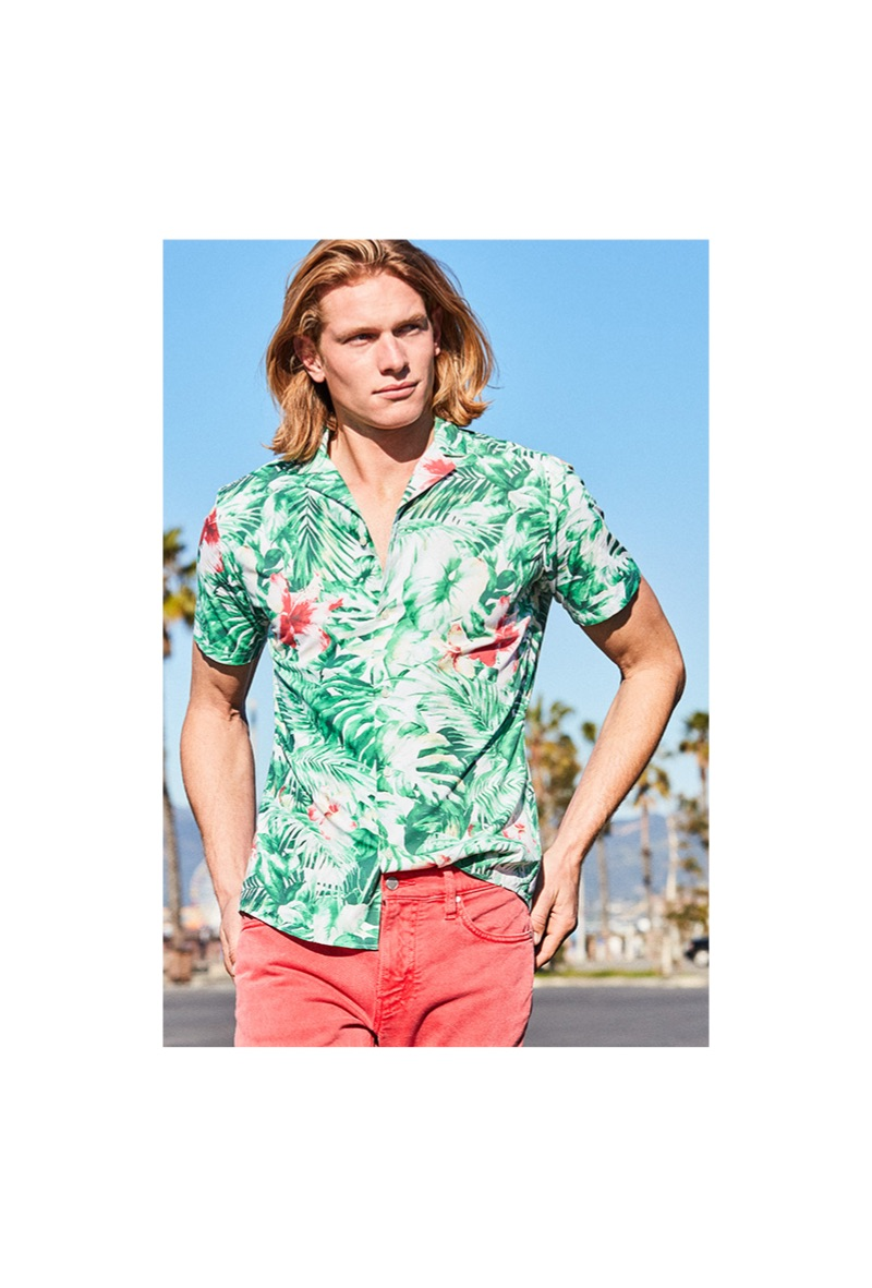 Hunter Bach sports a green Michael Kors slim-fit jungle-print camp shirt $98.
