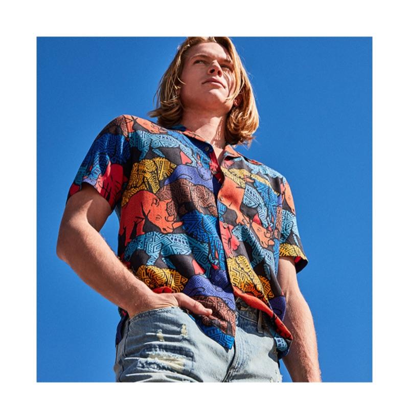 Embracing a colorful print, Hunter Bach models a Tasso Elba Congo graphic camp collar silk shirt $65.