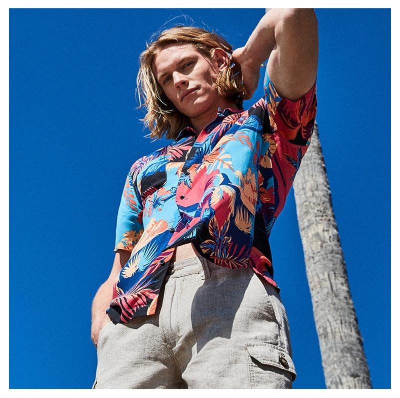 Ready for summer, Hunter Bach sports an American Rag men's tropical dual pocket shirt $40.