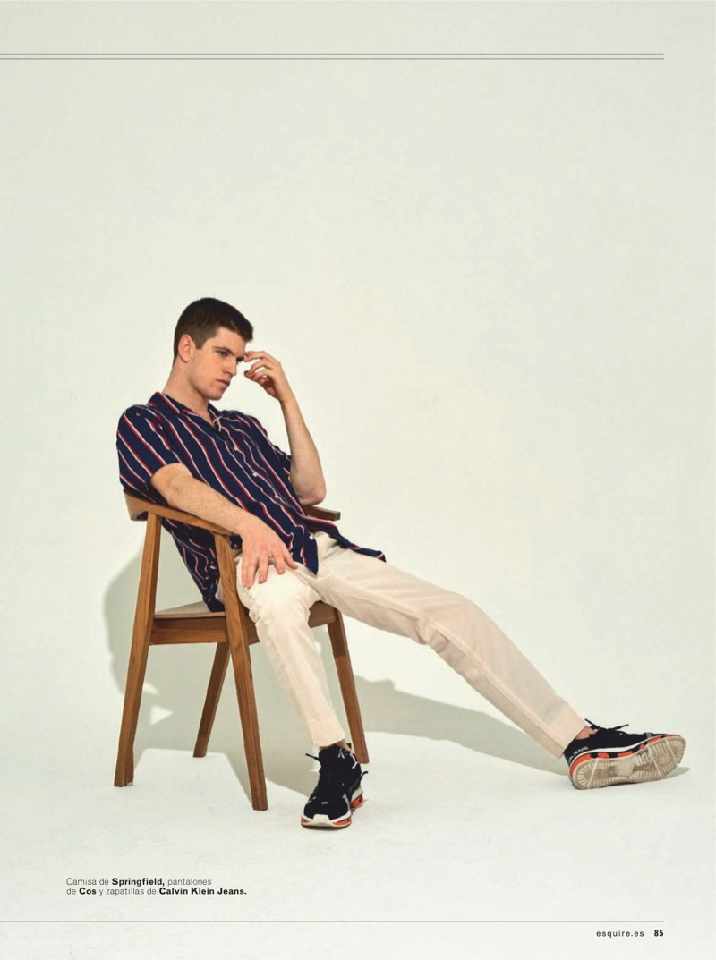 Sitting for a photo, Miguel Bernardeau dons a Springfield shirt, COS pants, and Calvin Klein Jeans shoes.