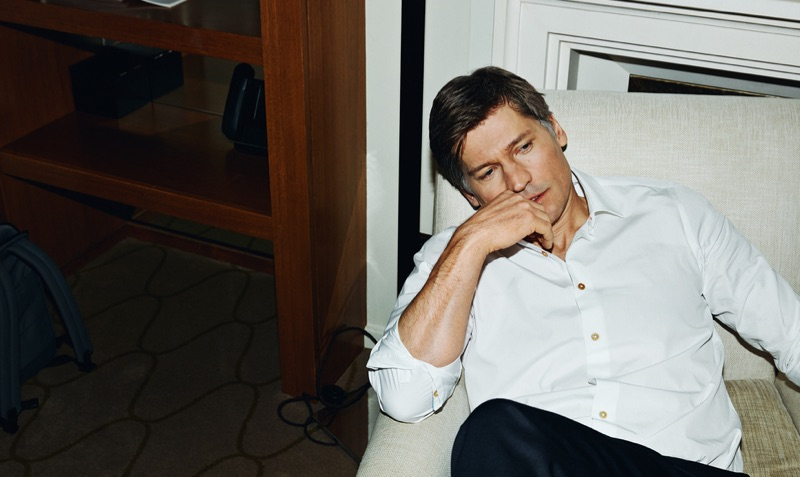 Starring in a new photo shoot, Nikolaj Coster-Waldau dons a Paul Smith shirt and BOSS pants.