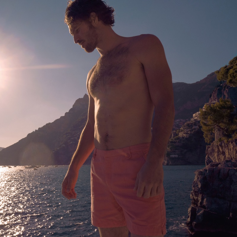 Wearing a shade of pink, Justice Joslin rocks a pair of Thunderball Day shorts $295 from Orlebar Brown's 007 collection.
