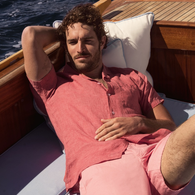 Connecting with Orlebar Brown, Justice Joslin wears the brand's 007 Thunderball shirt $295 with a capri collar.