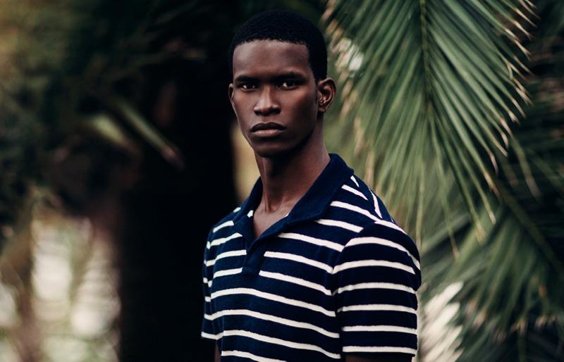 Salomon Diaz dons a striped polo shirt by Orlebar Brown.