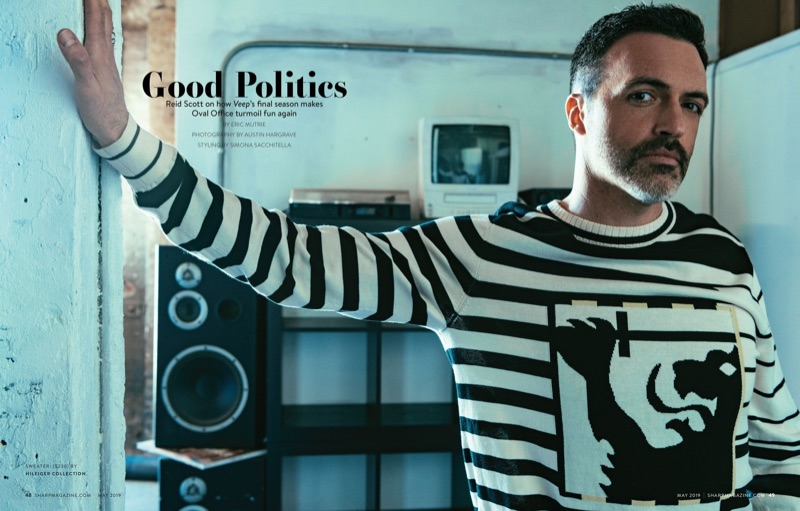 Reid Scott wears a striped sweater from Hilfiger Collection.