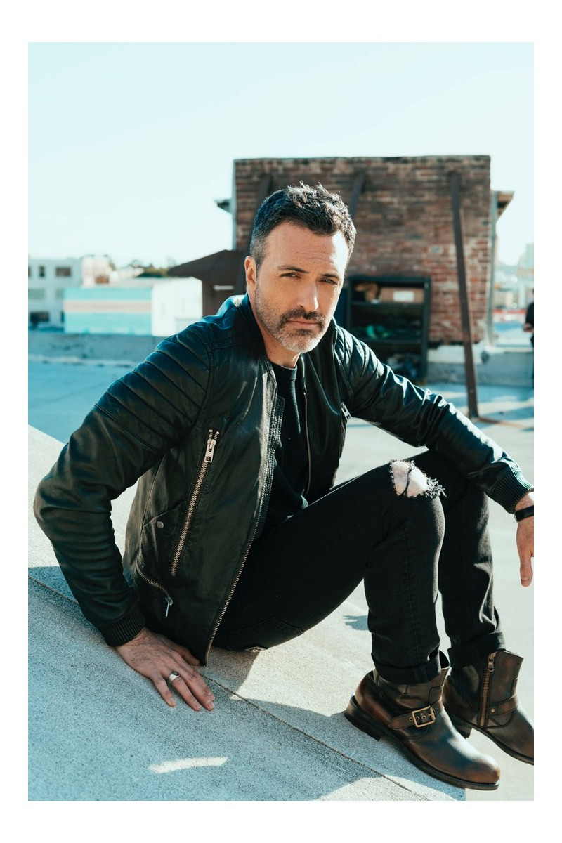 Actor Reid Scott dons an AllSaints leather jacket with Dolce & Gabbana jeans and his own boots.