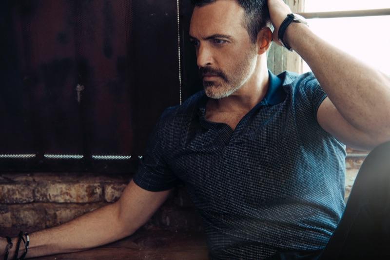 A smart vision, Reid Scott wears an Ermenegildo Zegna shirt, AllSaints pants, and a Cartier watch.