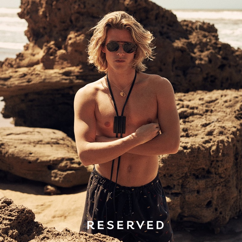 Taking to the beach, Biel Juste sports swim shorts from Reserved's summer 2019 collection.