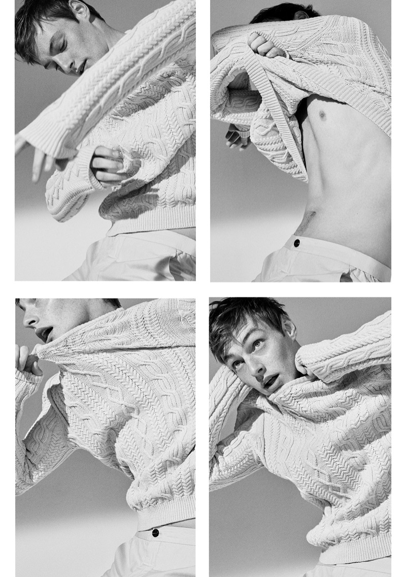 Donning a cable-knit sweater, Roberto Sipos wears Massimo Dutti.