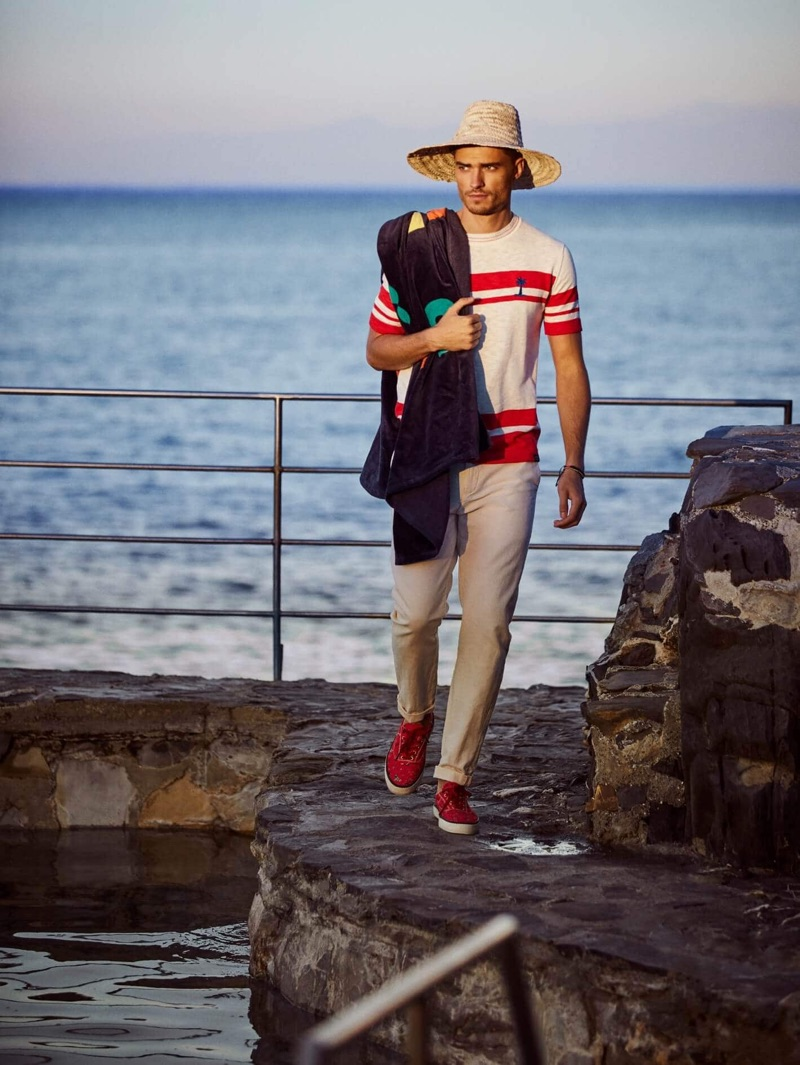 Going for a walk, Ivan Kozak sports a Scotch & Soda Placement red stripe t-shirt $125 with cotton-linen trousers $148.