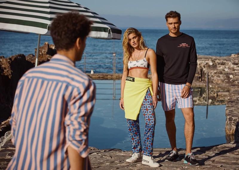 Model Ivan Kozak steps out in Scotch & Soda's preppy stripe swim shorts $89.
