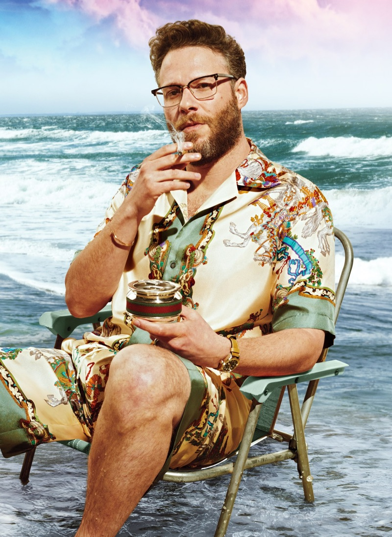 Sporting coordinated pieces, Seth Rogen dons a silk shirt and shorts by Gucci with a Tudor watch.