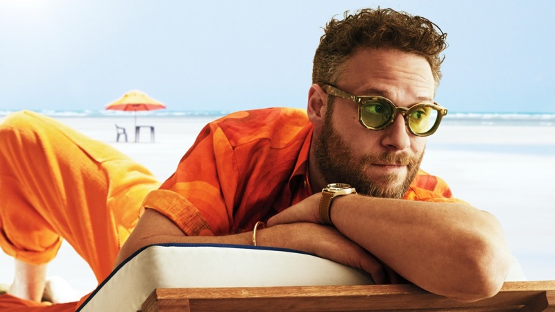 Actor Seth Rogen wears a Dries Van Noten shirt, The Elder Statesman pants, White Mountaineering x Jacques Marie Mage sunglasses, and Tudor watch.