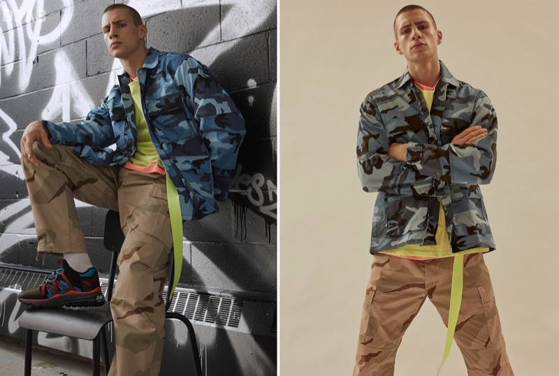 Mixing camouflage prints, Augusta Alexander sports a ROTHCO blue tactical camo shirt and camouflage cargo pants with a neon DJAB t-shirt. He completes his look with a yellow Outcome belt.