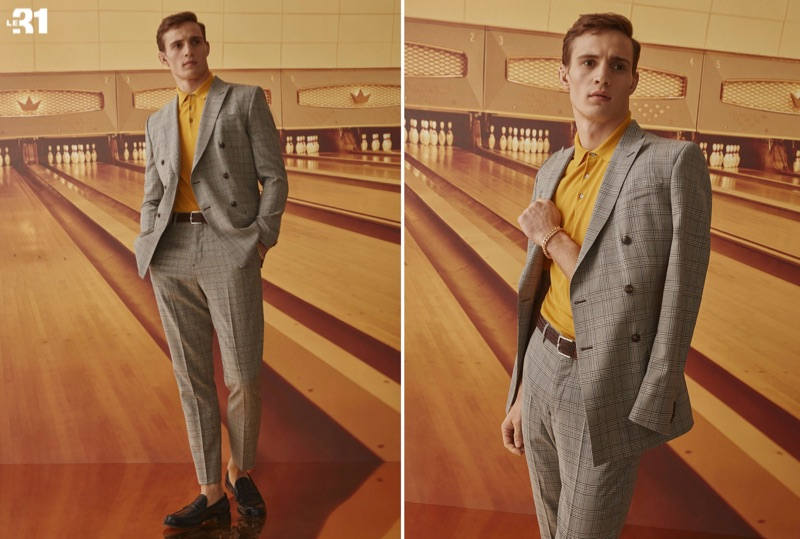 Julian Schneyder dons a LE 31 caramel Prince of Wales double-breasted jacket and suit pants with a dark yellow silky knit polo.