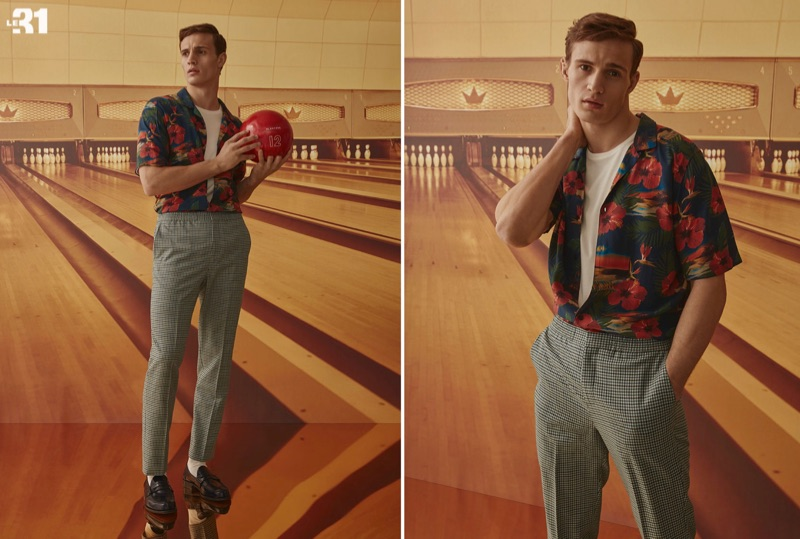 Model Julian Schneyder wears an island flower print shirt and gingham jogger pants by LE 31.
