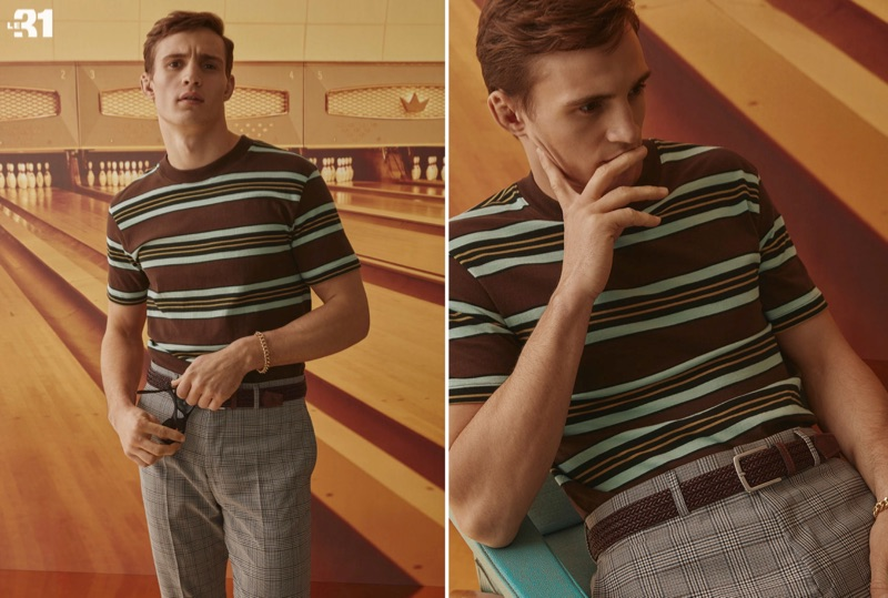 Front and center, Julian Schneyder dons a LE 31 retro striped t-shirt, braided leather belt, and gingham suit pants.