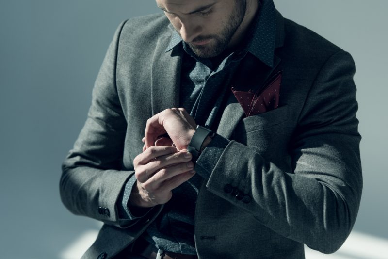 Stylish Man in Suit Checking Watch