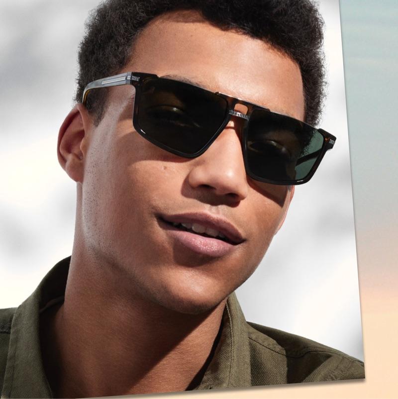 Embracing a 1980s-inspired shape, Nicolas Arcangeli wears Versace sunglasses $245.