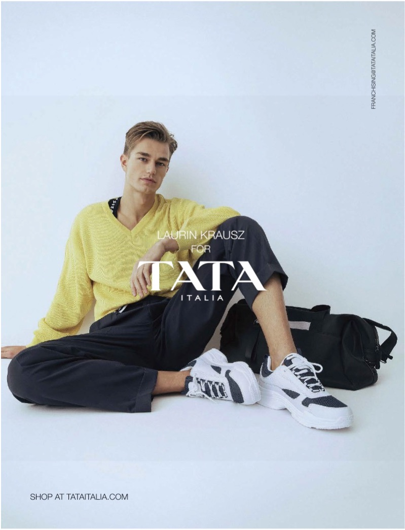 Sporting a yellow sweater, Laurin Krausz fronts TATA Italia's spring-summer 2019 campaign.