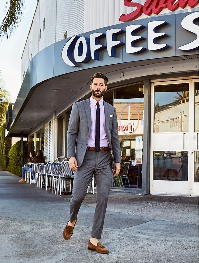 Stepping out, John Halls dons a light charcoal Todd Snyder White Label Sutton stretch tropical wool suit jacket $398 and suit trousers $198.