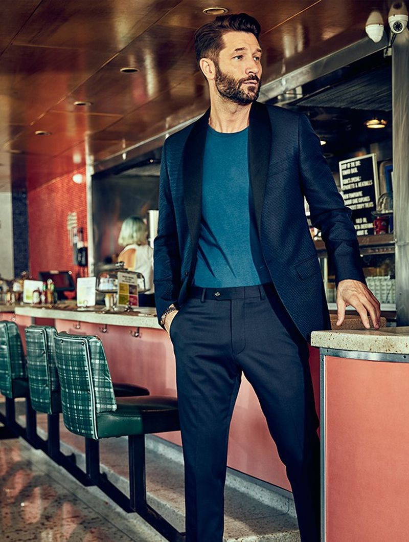 Fronting an elegant outing for Todd Snyder, John Halls wears the brand's Black Label silk textured jacquard Sutton shawl collar dinner jacket $798 in navy pindot with Sutton tuxedo pants $348 in black Italian wool.